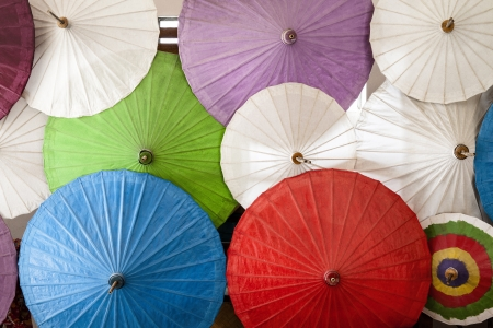 bowery: Close up of colorful umbrellas  Colorful umbrellas with wooden handle  Stock Photo