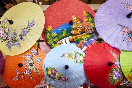 bowery: Close up of colorful umbrellas  Colorful umbrellas with wooden handle, craft from Chiang Mai,Thailand  Stock Photo