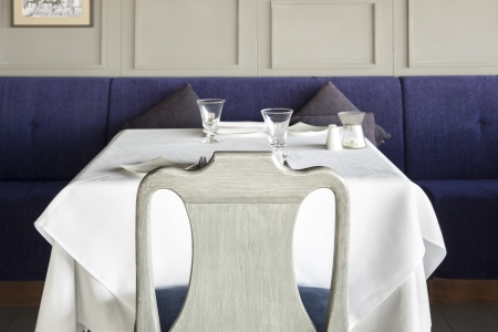 Chair and table setting at restaurant  Grey chair with Table in grey room and blue sofa  photo