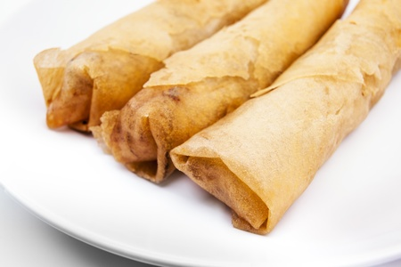 Spring rolls   Dim sum or Loempia , cuisine on white background  Spring rolls are a large variety of filled, rolled appetizers  Stock Photo