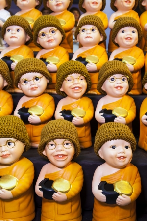 buddha image: Little monk dolls and Little nun dolls  Cute monk dolls and cute nun dolls with alms-bowl, product from Thailand