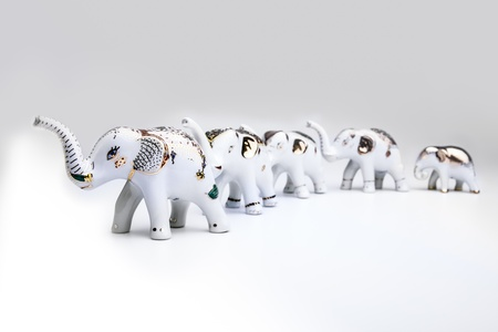 potent: Herd of elephant ceramic, product from Thailand  The Thai people have a long, shared history with the elephant and today the elephant remains a potent national symbol