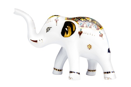 potent: Beautiful elephant ceramic, isolated with clipping paths on white background  The Thai people have a long, shared history with the elephant and today the elephant remains a potent national symbol