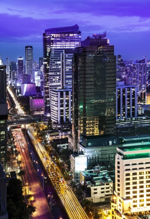 Traffic in modern city at night, Sathorn Rd , Bangkok s CBD, Thailand  Bangkok is the capital city of Thailand and the most populous city in the country  photo