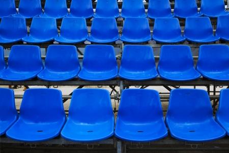 fluting: Empty plastic seats at stadium, open door sports arena  Stock Photo