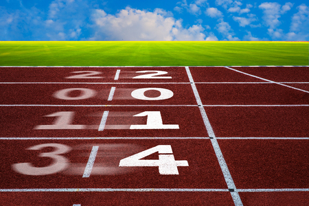New Year 2014 on running track concept with blue sky  New Year, beginning, Competition and goal concept, white number on new running track with green grass and blue sky  Stock Photo