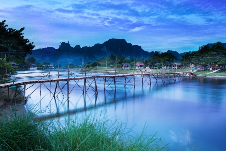Country bridge across Nam Song river, Vang Vieng, Laos  Vang Vieng is a tourism-oriented riverside town and backpacker s paradise in Vientiane Province