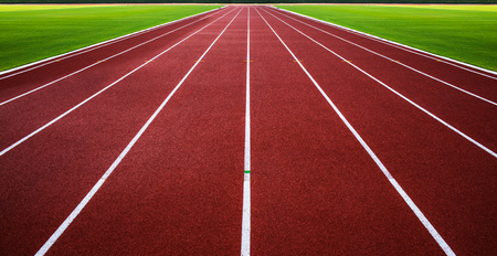 New running track with green grass abstract, texture, background  White lines on red running track with green grass in The National Stadium of Thailand or Suphachalasai Stadium, Bangkok  photo