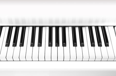 White grand piano key closeup photo