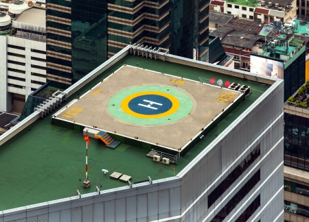 rescue helicopter: Helipad  Helicopter landing pad  on roof top building  Helicopter landing pad on roof top building in Bangkok, Thailand