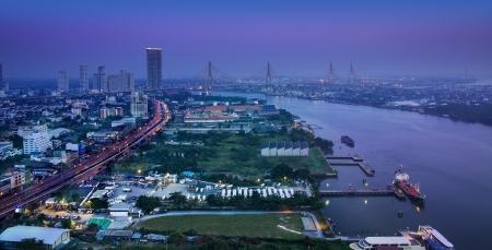 chao phraya river: Modern city in a green environment, Chao Phraya River, Bangkok,Thailand   Stock Photo