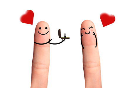 marry me: Will you marry me , isolated with clipping paths on white background  Cute couple in love with diamond ring and red heart