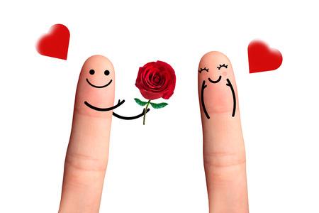 Couple dans l'amour avec le smiley, Donner une rose, isol� en blanc Banque d'images