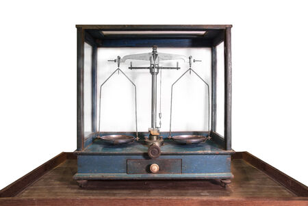 plaintiff: Antique balance scale in wood cabinet - Pharmacy Chemist Gold Diamond Balance Scale
