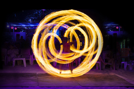 Fire show at Ko Phi Phi Don, Phi Phi Islands, Krabi province, Thailand  - Fire performance, A fire twirler with staff