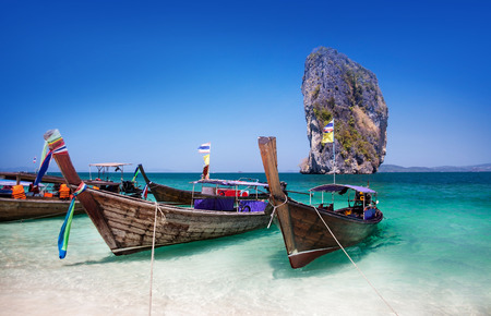 Boat on the beach at Phuket Island, Tourist attraction in Thailand  - Phuket is an international magnet for beach lovers and serious divers in the Andaman Sea