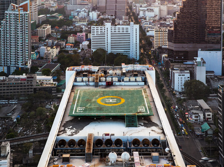 heliport: Helipad  Helicopter landing pad  on roof top building  - Helicopter landing pad on roof top building in Bangkok, Thailand