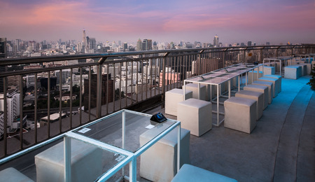 Table   chairs at terrace, urban city skyline, Bangkok, Thailand   - Bangkok is the capital city of Thailand and the most populous city in the country  photo