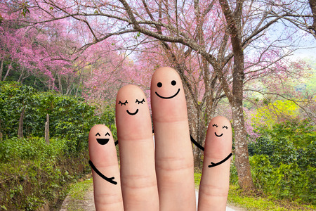 Happy family on the road  travel, environmental protection concept  4 fingers with road, sakura and green trees  photo