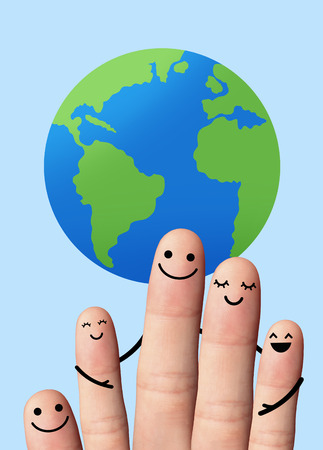 Happy family with the earth, travel, environmental protection concept  5 fingers with the earth on blue background  photo