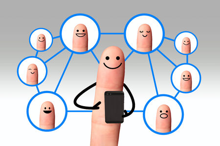 Happy finger, Social network concept, isolated with clipping paths  Happy finger using mobile phone with social network people  photo