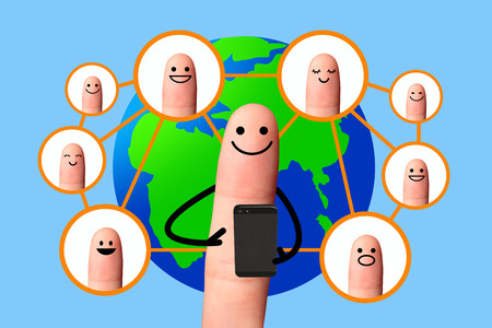Happy finger using mobile phone with world map, Social network concept  photo
