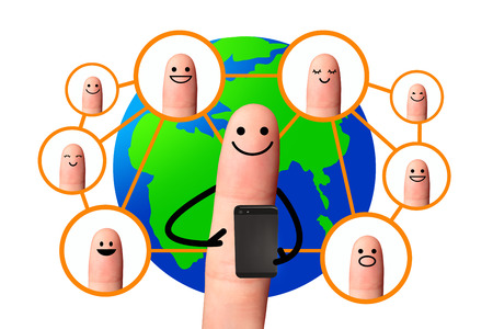 Happy finger using mobile phone with world map, Social network concept  isolated with clipping paths  Reklamní fotografie