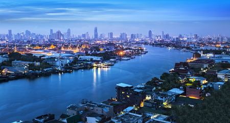 Chao Phraya River with Grand Palace   Wat Phra Kaew, Bangkok,Thailand  Grand Palace and Wat Phra Kaew or Temple of the Emerald Buddha are located in the historic centre of Bangkok  photo