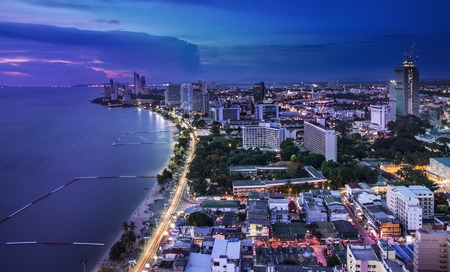 Urban city Skyline, Pattaya bay and beach, Thailand  - Pattaya is a most popular beach resort with tourists and expatriates  It is located on the east coast of the Gulf of Thailand, southeast of Bangkok in the province of Chonburi Stock Photo - 29440137
