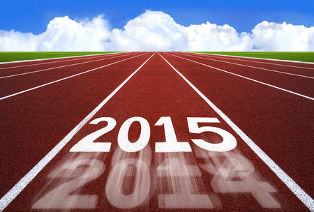 New Year 2015 on running track concept with blue sky. - New year concept,  competition concept, sport concept. photo