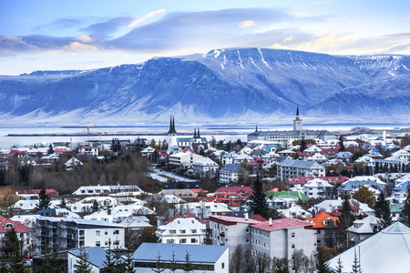 Beautiful aerial view of Reykjavik city, Iceland. with harbor and skyline mountains, seen from the Perlan The Pearl Фото со стока