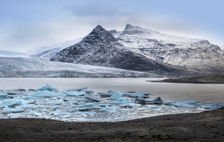 fjallsarlon: Iceberg at Fjallsarlon glacier lake, Iceland -This is a glacier lake at the south end of the Icelandic glacier Vatnajokull Stock Photo