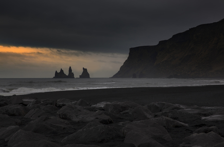 southernmost: Black sand of Reynisfjara beach at Vik i Myrdal, Iceland. Vik i Myrdal The village of Vik is the southernmost village in Iceland