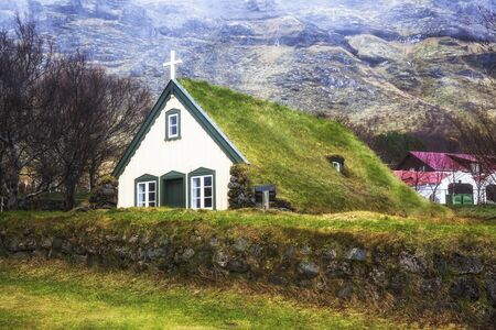 church: Last turf church of Hof in Iceland,built in 1884,traditional Scandinavian type of green roof