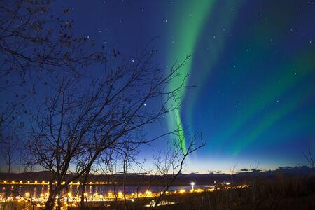kiruna: Aurora with the light on the horizon at Kiruna Cityscape, Sweden.  Kiruna is the northernmost town in Sweden, near Abisko national park