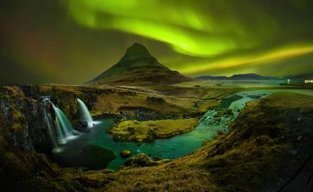 Aurora at Kirkjufell and Waterfall Kirkjufellsfoss, Landmark of Iceland. Kirkjufell Church mountain is mountain on the north coast of Iceland's Snfellsnes peninsula.