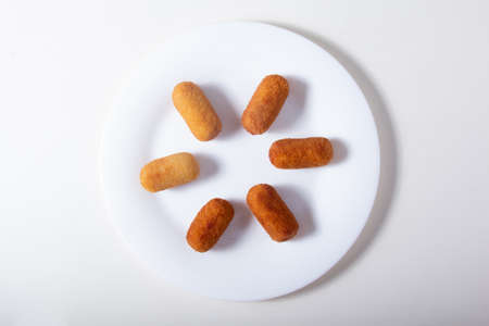 Delicious fried Croquettes ready to eat Tasty and delicious Deep-fried Croquettes orderly displayed on a white plate.