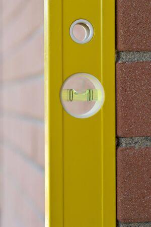 exactness: Spirit Level againt vertical brick wall