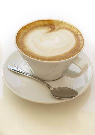 coffeebreak: Frothy cappuccino coffee.