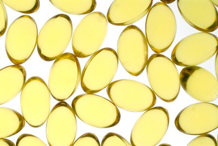 fishy: Close up of gel yellow capsules containing high concentrate fish oil, rich in essential fatty acids.