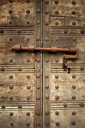 Medieval door bolt locked door Stock Photo - 661634