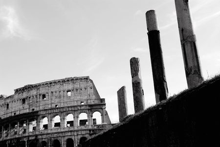 Black and white picture of the Roman Colosseum and Ancient Columns Roman Forum photo