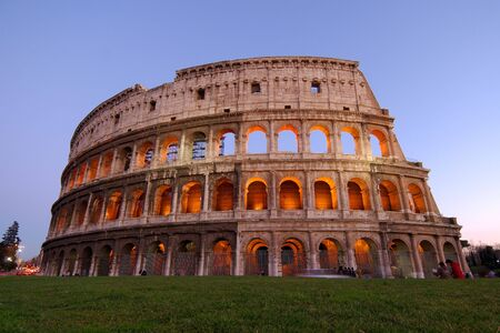 Stunning view of the roman colosseum lit at dusk photo
