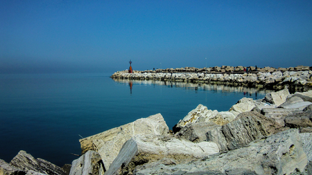 Heavenly view of the pier of the port of Giulianova in Abruzzo Italy. A mystical landscape in which the orrizzontre line between sky and sea merge into a unique spectacle. Imagens