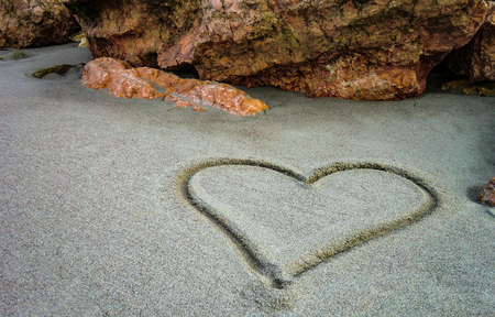 madly: A heart drawn on the sand of the unspoiled beach: a gesture of sweet and poetic love for those who truly love