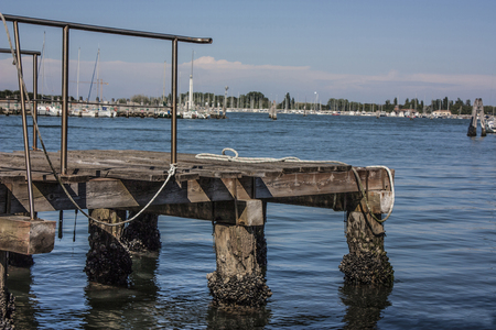 parapet: Small wooden mooring for medium and small boats on the Venice lagoon.