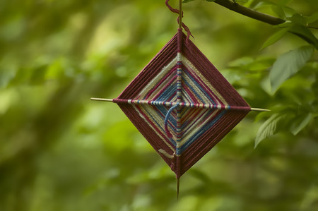 shamanic: Small spiritual amulet in fabric hanging from a tree at a shamanic ceremony. Stock Photo
