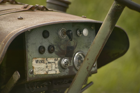 Instrument panel and speedometer of an old vintage tractor used for working on a farm. Stock Photo