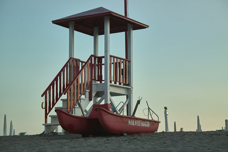Lifeboat and lifeboat in a bathing establishment of Rosolina Mare in Veneto, Italy. Rescue Station for beach bathers.