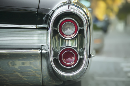 Detail of a rear axle of a vintage American car from the 1960s with well visible chrome and micro detail.